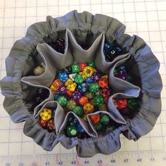 Custom Order for a grey Colossal Bag of Many Dice with 10 pockets. Turned out great! 7 pockets, for the 7 different dice types, 2 pockets for 2 special sets of dice, 1 pocket for their FATE dice set and the center compartment was for miscellaneous.
