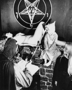"zeena lavey nude - ANTON SZANDOR LAVEY  Anton Szandor LaVey, a self-styled sorcerer, performs a ""satanic baptism"" on his three-year-old daughter, Zeena Galatea, with assistance from his partner, Diane, right. The ""priestess"" of Lavey's satanic church, Isabel Bolotov, poses in the nude on the fireplace mantle used as an altar. San Francisco, CA, May. 24, 1967."