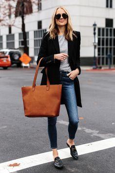 168d628962e Blonde Woman Wearing SLATE Cognac Tote Black Wool Coat Grey Sweater Denim  Skinny Jeans Gucci Mules