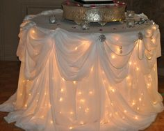 Lights under the cake table ~ adds a kind of starlit ambiance.