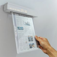 IN Electronic newspaper and alarm clock Hung on your wall, this electronic newspaper is made of a flexible LED display, and uses Wi-fi to keep you posted every morning.