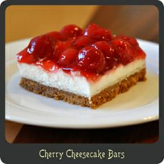 Cherry Cheesecake Bars--One of the many reasons I LOVE this recipe is that it is quick and effortless to make. There is no need to wait for cooking and cooling for hours like a traditional cheesecake. This takes less than 20 minutes to make and just an hour to cool. It just doesn't get any easier.