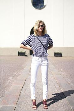 Shop this look on Lookastic:  http://lookastic.com/women/looks/grey-sunglasses-navy-and-white-long-sleeve-t-shirt-white-skinny-jeans-burgundy-heeled-sandals/8780  — Grey Sunglasses  — Navy and White Horizontal Striped Long Sleeve T-shirt  — White Skinny Jeans  — Burgundy Leather Heeled Sandals