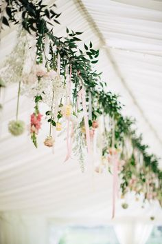 Hanging flower garland | Photography by www.mandjphotos.com/