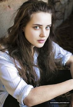 "{ Katherine Langford } ""Hey. I'm Hannah. I am 17 and single. I'm known as the school slut. I also have the best ass in school and like to make out with other girls. I'm not a happy young teenager like everybody assumes I am. You'll hear more about me as the time comes. You just need to listen."""