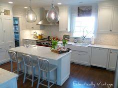 love the herringbone tile backsplasha nd lighting in this kitchen