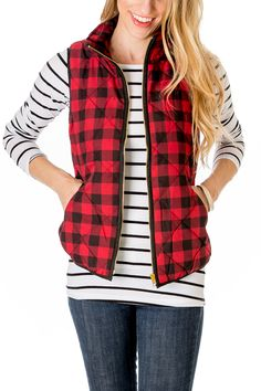 This plaid puffer vest features an all-over red and black check print.
