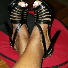 MICHAEL KORS HEELS Black MICHAEL KORS HEELS with gold mk symbol on the bottom of shoes and a little strap is missing it's better explained in the picture Michael Kors Shoes Heels