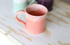 Hand-thrown colorful pottery mug, perfect for a mix and match dining set, as well as drinking your morning coffee or giving as a gift!  This petite mug is perfect for a small cup of tea or a childs portion. Dishwasher safe, this mug is a functional as it is beautiful!  Size is approximately 3.25 inches at the rim and 3.5 inches high. All pottery is handmade. Each piece is individual ~ one of a kind. Please understand all the slight variations are a sign of hand crafted pottery. Our work is…