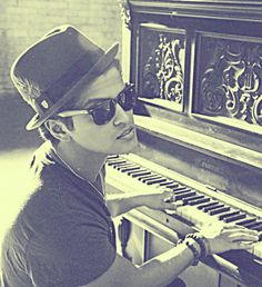 bruno mars, dirty little lover! I melt when he sings! He has a voice to make you wanna explode with feels!