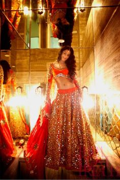 orange ghagra, long sleeve blouse, mirror work, ornate