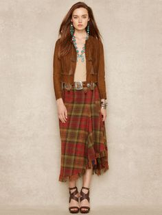 This luxuriously soft woolandcashmereblend skirt features an asymmetrical draped silhouette a rustic plaid pattern and a playful fringed hem. #Fashion  #Clothing