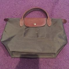 """Authentic Longchamp Le Pilage (Small) Bag 100% authentic Longchamp. Le Pilage Type """"S"""" - Modele Depose. Decent used condition. There are 3 small white marks on the front exterior. Otherwise decent used condition. Color: Olive Green. Vinyl. Dimensions are: 12.5"""" x 5.5"""" x 9"""" with a 3"""" strap drop. Longchamp Bags Mini Bags"""