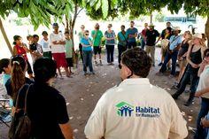 Members of Build Louder team, incl. staff from tithe partner Sea Island HFH (SC), met with Arroyos y Esteros neighborhood in Asuncion, Paraguay. Nov. 2011
