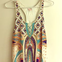 Parker beaded dress (small) Gorgeous Ladies size small beaded Parker dress worn once. In perfect condition! Great dress for summer dress event- wedding, cocktail, wedding rehearsals,  engagement pictures, etc.   Dress is completely beaded with beautiful handcrafted colored beads. Scoop neckline. Dress is absolutely stunning on.  Beads are, pink, orange, various shades of blue, gold, etc.  length of the dress- about 4inches above knee. Parker Dresses Midi