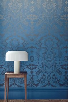 An elegant damask wallpaper panel by Little Greene with a light to dark fade running from top to bottom. Shown here in the blue Cobalt Fade colourway.