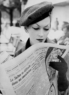 Dovima, August 1955. Hat and suit by Christian Dior. Photographed by Richard Avedon at Fouquet's, Paris.