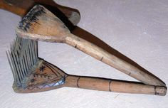 Two combs (with steel spike teeth) used in carding wool for spinning