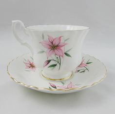 Made by Royal Albert, this tea cup and saucer are white with pink flowers. Gold trimming on cup and saucer edges. Excellent condition (see photos). Markings read: Royal Albert Bone China England Please bear in mind that these are vintage items and there may be small imperfections