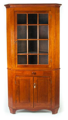 "Garths | Lot 371 AMERICAN CORNER CUPBOARD.  Mid 19th century, cherry with poplar secondary. Two-piece cupboard. Two doors with twelve panes of old glass and a base with dovetailed drawer over two doors. Refinished with replaced feet. 85""h. 44""w.  Estimate $ 600-800"