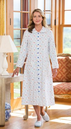 Lanz floral printed duster has feminine satiny piping and ruffled trim.  This cotton flannel housecoat includes easy-dressing full snap front and  patch ...