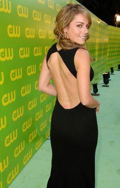 Erica Durance in a sleek curve hugging black dress