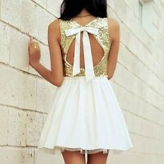 Loveee this open back dress.. Bows and sequins make everything cuter