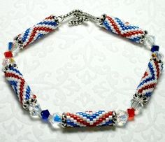 Patriotic Crystal Bracelet Pattern. Swarovski crystals, and Delica bead handmade peyote tubes make a colorful red, white and blue sparkly bracelet. The colors of the American Flag can be worn any time!