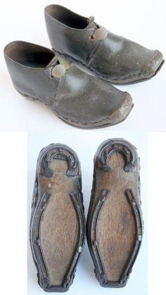Child's shoes, early 18th Century, dark brown leather, wooden sold, small brass buckles, height 2 3/4, lenght 5 1/2 inches.