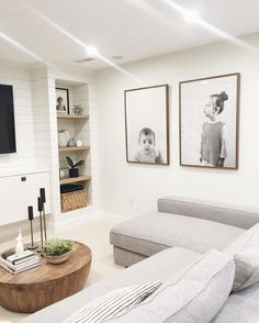 The living / lounge room. Love the big photo prints! light bright basement even without windows