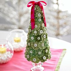 Christmas: Fabric scrap yo-yos... with button center...  pinned to styrofoam cone.... mounted on glass candleholder.  (Could be cute in pink for girl's room)