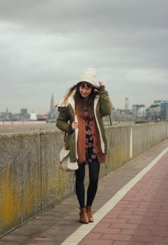 Parka, long cardigan, dress or loose T, tights or skinnies, and boots. cozy stylish layers