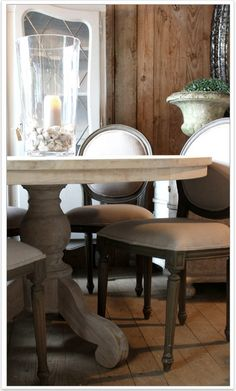 Oh loving this combination of design here. Rustic vertical wood planking on wall, french colored dining table in weathered gray with creme/beige.