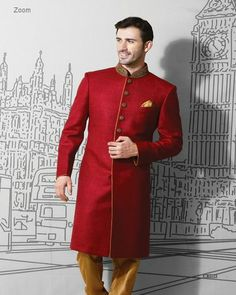 SOLID ZENNIA RED SHERWANI. Men who wish to carry tradition and culture through their wedding trousseau, this piece is just menat for you. Minimal in appearance and bold in color story, people who just like to stay minimal and different, and this is it for you. Pair it up with yellowish golden chudidar and maroon jooti to complete the look.