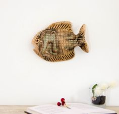 Ceramic Animal Decoration. 3D wall Art Decor Fish sculpture. A wonderfully hand formed and sculpted ceramic wall decoration.     Dimensions:  ~ 7 1/2 in x 5 1/4  in (~ 19 cm x 13,5 cm)   height from wall: ~ 1 1/2 in or ~ 4 cm   weight: 11 oz. or 320 g    The product is made of natural clay. Natural clay color, decoration is not under glaze, glaze binder only part - that highlights the features of the product.   This handmade sculpture of a fish is designed to mount on the wall on a screw or…