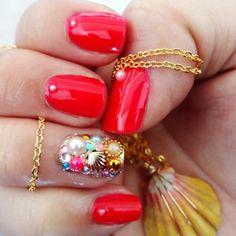 Bright pink mani with treasure trove feature nail.