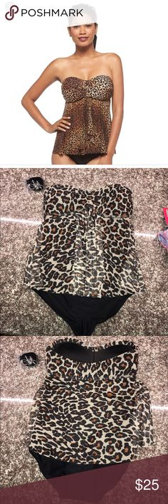 NWOT LEOPARD ONE PIECE NWOT LEOPARD MERONA ONE PIECE. COMES WITH ATTACHABLE STRAP. SUPER CUTE DESIGN. Size small. Bandeau flyaway top with black bottom piece. Brand is merona. Tags-merona. Victoria's Secret. Asos. Xhilaration.shade and shore.  32a 32b 32c 32b 32d 32dd 34b 34c 34d 34dd 36a 36b 36c 36d. Swim. Swimsuit. Bikini. Monokini. Not Maternity. Regular. Tankini. One piece. Victoria's Secret Swim One Pieces