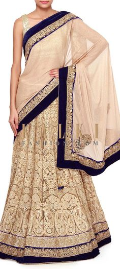 Buy Online from the link below. We ship worldwide (Free Shipping over US$100). Product SKU - 273629.Product Link - http://www.kalkifashion.com/beige-lehenga-saree-adorn-in-thread-and-sequin-embroidery-only-on-kalki.html
