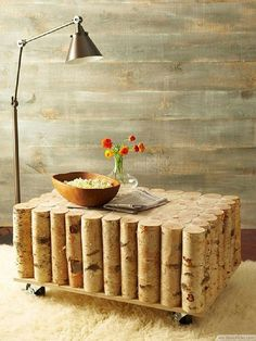 For those who very love nature and like to bring it even in their own home through natural materials here is an idea how to refresh their space. Table made of logs of wood is an excellent solution for them.