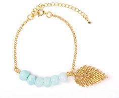Charming handmade bracelets with 6 blue opals and beaded leaf from Japanese beads, gold plated chain 14 k.