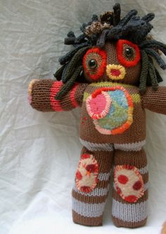 she is lovin this great outdoor weather -hopefully she will not run away after the pictures-all hand knit doll organic cotton hand knit hair and recycled patched sweaters on body-inner body of cotton tubing and wool-she stands 13 inches high