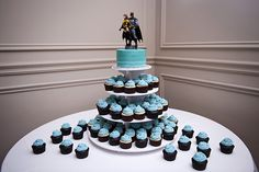 Like the cupcakes...the batman/woman cake topper is much to be desired