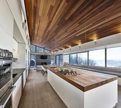 HORITONTALITY Congratulations to this week's #idpicks winner for modern kitchens, @RobitailleCurtis! Link in bio for the rest of the winners. ☝️ Pictured here is their Laurentian Ski Chalet in Quebec, which features a large central island containing a gas cooktop and a prep sink. A 27-foot-long bay window, complete with a seating nook, brings in abundant natural light and offers sweeping views of the snow-blanketed Mont-Jasper. : Marc Cramer. @sandow