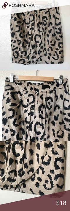 "Faux Wrap Skirt by F21 This cute leopard print skirt features a faux wrap effect in front and hidden rear zipper. Black and tan color scheme is prefect for fall. Match with a bodysuit and leather coat... instant Fashionista! Fabric does not feature stretch. (Waist 14.75"" Length 18"")   New condition  No Trades, Price Firm, and Bundle your likes to receive private offer!  Same Day shipping before 3pm (Mon- Fri) Noon on Saturday (PST) Forever 21 Skirts"