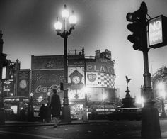 The advertising signs in Piccadilly Circus are switched off in tribute to Sir Winston Churchill. 1965.
