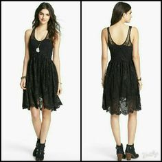 Free People Black Lace Salinas Foil Dress This dress is brand new. It is the Kristal Lace Salinas Foil Dress in Black. The metallic flecks in this dress are so subtle, just a hint of magic. Overlay on skirt opens in front for extra movement. Sweatheart neckline on lining shows through sleeveless lace shell. Made of 100% polyester. Tag size is 4. Free People Dresses