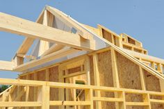 Timber frame with OSB sheathing, glulam beams and trussed