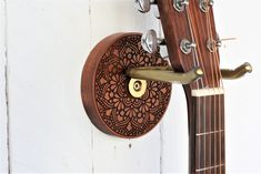 Spring Cleaning and organising your home? Looking for a beautiful handmade house warming gift? Things For Strings makes solid wooden holders for ukuleles, guitars, mandolins and banjos. #housewarming #springclean #organiseyourhome #homedecor #musicroom #ukulele #guitar #wallhanging #wallmount #hanger #handmade #giftsforhim #giftsforher #music #guitarhanger #hook #woodhanger #wallart #storageideas #handmadeinireland #guitarwallmount #ukulelewallmount #uke Ukulele Wall Mount, Guitar Wall Hanger, Handmade House, Handmade Wooden, Organizing Your Home, Organising, Banjos, Home Look, Spring Cleaning