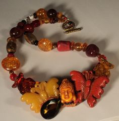 Wendy Gell Bakelite looking Spice color Buddha with Butterflies necklaces.. $144.99, via Etsy.
