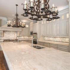 """Stunning kitchen in this Danny W. Abdo Luxury Home. Taj Mahal quartzite countertops. #naturalstone @LevantinaDallas, fabrication by Cornerstone Granite &…"""